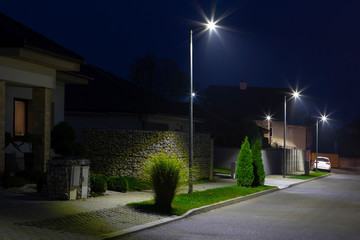 street in a residential area with modern streetlights Fotomurales
