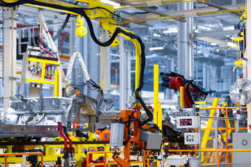 robot arm holds the detail of car. Car manufacturing plant