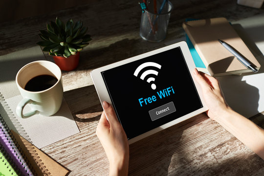 Free wifi connection on device screen. Internet and wireless technology concept.