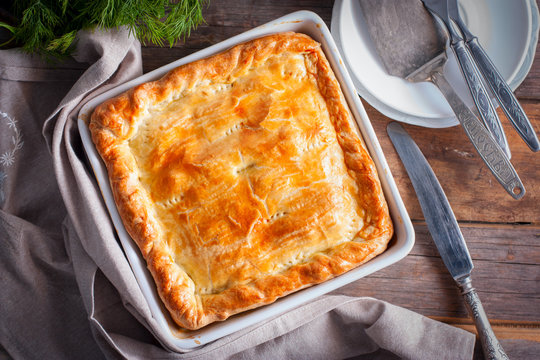 Puff pastry pie with chicken, potatoes and onions, quute pie, selective focus, top view