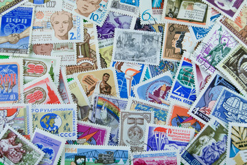Postage stamps of different countries and times. Background.