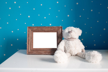 teddy bear with blank photo frame