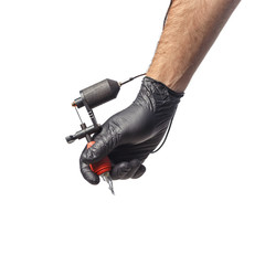 Tattooist hands in black gloves with tattoo machine isolated on white background.