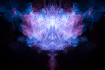 Abstract image of smoke of different colors in the form of horror in the form of the head of the face and eyes on a black isolated background. Soul and ghost in mystical form. Wall mural