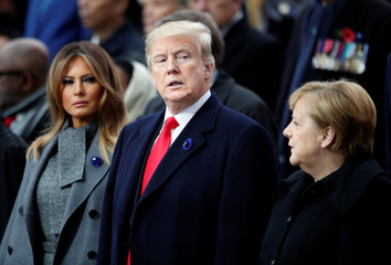 U.S. President Donald Trump, his wife Melania Trump, and German Chancellor Angela Merkel attend a commemoration ceremony for Armistice Day, 100 years after the end of the First World War at the Arc de Triomphe, in Paris