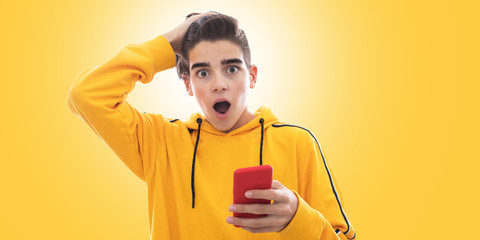 young teenager with mobile phone and isolated expression