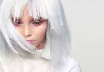 Portrait of a girl in a white wig, fabulous image.