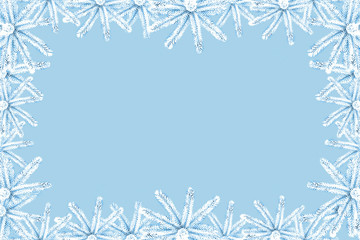 Christmas background with snow-covered blue spruce on canvas with a place for an inscription. Stylish color correction