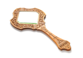 Ancient wooden hand mirror lies on a white background