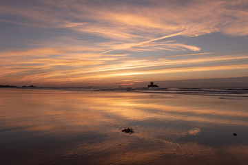 Gorgeous reflections at sunset on St Ouens Bay beach, Jersey, Channel Islands