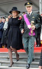 Belgium's King Philippe and Queen Mathilde attend a wreath laying ceremony at the Tomb of the Unknown Soldier during celebrations marking the 100th anniversary of the end of the First World War in Brussels