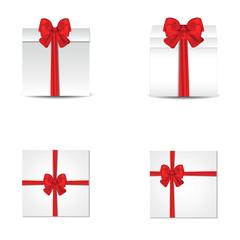Collection of gift boxes with satin red bows.