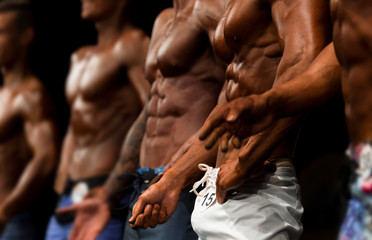 group athletes bodybuilders posing most muscular fitness competitions