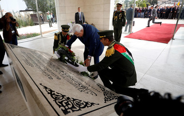 Palestinian President Mahmoud Abbas lays a wreath on the tomb of late Palestinian leader Yasser Arafat during a ceremony marking the 14th anniversary of Arafat's death, in Ramallah, in the occupied West Bank