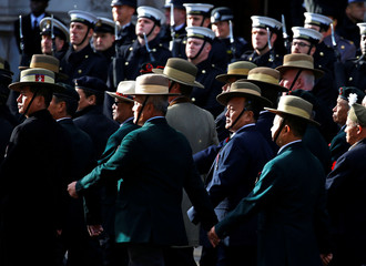 Military veterans parade along Whitehall during a National Service of Remembrance at The Cenotaph in Westminster, London
