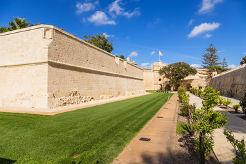 Mdina, Malta. Former fortress moat turned into a park, walls, gate, bridge