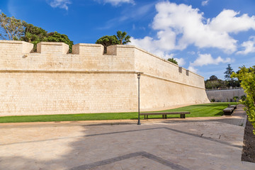 Mdina, Malta. A view of the fortress walls from the side of the moat