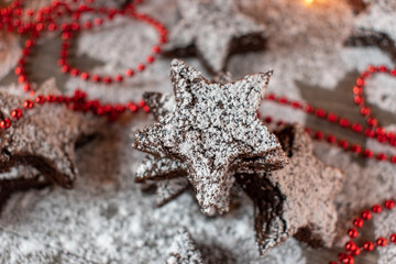 Christmas star brownies with powdered sugar and red beads