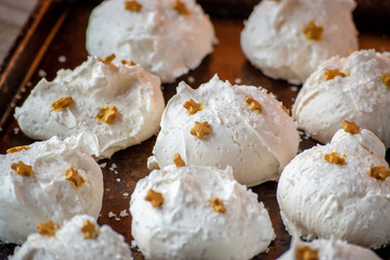 Christmas Meringue cookies with gold stars for the holidays