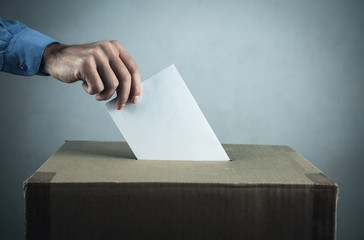 Voting at the ballot box. Election and democracy concept