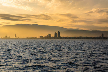 City landscape of İzmir. Foggy city background at sunset.