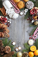 Christmas background with stollen cake, traditional sweets and festive decoration. Overhead view, copy space