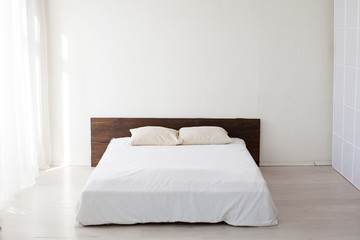 large bed in the Interior white bedrooms