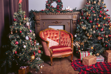 Luxurious interior with two large Christmas trees with lots of toys and garlands