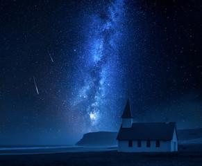 Milky way over small church on the beach, Iceland