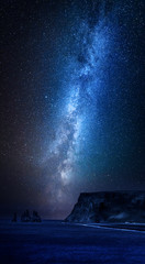Fototapete - Milky way over black sand beach at night, Iceland