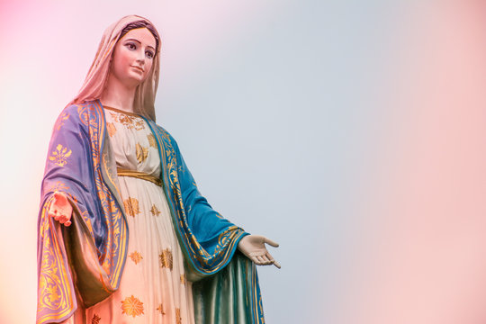 Virgin Mary statue with colourful background, Jesus christ mother.