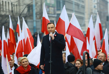Poland's President Andrzej Duda delivers a speech before the official start of a march marking the 100th anniversary of Polish independence in Warsaw