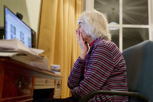Old elderly senior person learning computer and online internet skills