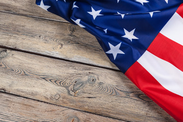 USA flag on light wooden table background close up copy space