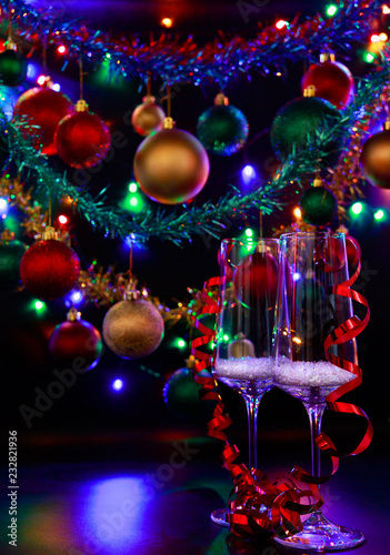 Colorful Christmas Lights Background.Two Champagne Glasses Against A Background Of Colorful