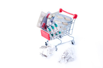 Full shopping cart of pills and check on white background. Health and medicine concept