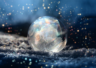 Magic frostball with snowflake glitter around