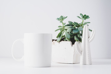 white mug mockup in a styled setting with a white background