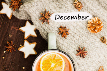 Winter theme. Hot tea with spices,orange,cinnamon,anise,cookies