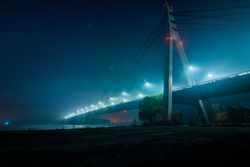Moscow North bridge, night panorama on illuminated construktion with beautiful reflections in Dnipro river