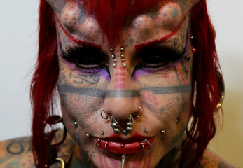 A Mexican tattoo artist attends the Art Tattoo Convention in La Paz