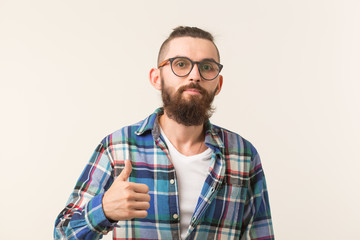 Gesture, fashion and people concept - Bearded hipster man with thumb up on white background