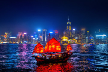 Wall Mural - Victoria Harbour with junk ship at night in Hong Kong.