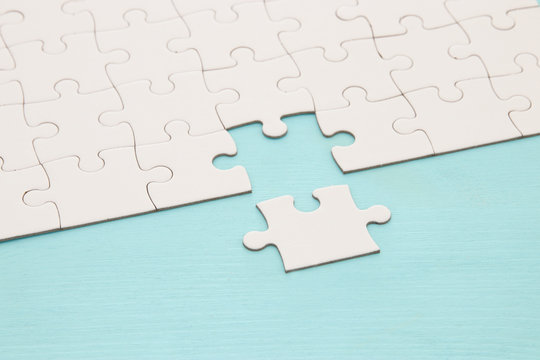 background of white puzzle with missing piece.