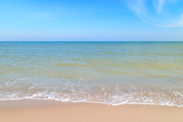 Sea wave on sand beach