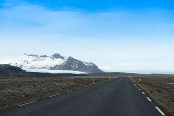 Empty road leading to snow covered mountains, Beautiful landscape in early winter of south Iceland