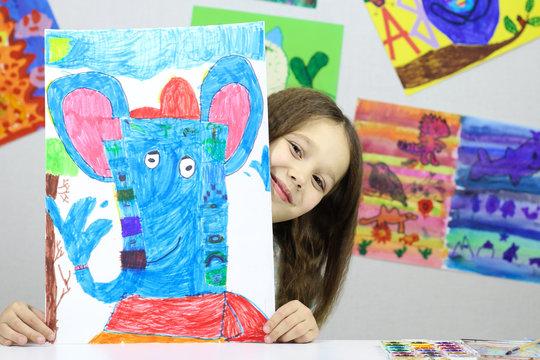child artist, little girl drew a picture of the God Ganesha