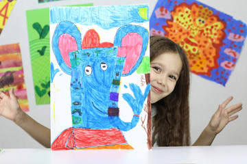 child artist, little girl drew a picture of the God Ganesha
