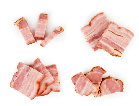 Pieces of bacon in different compositions close-up, top view.