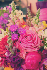 Natural macro background of fresh arranged flowers, retro toned